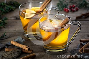 two-hot-toddy-cocktail-drinks-cinnamon-lemmon-whisky-rum-apple-brandy-set-rustic-wood-35766231